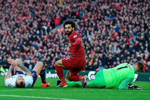 BACK TO WINNING WAYS: Liverpool's Mohamed Salah (c) turns to celebrate after scoring their third goal against Bournemouth at Anfield on Saturday. Photo; Getty Images