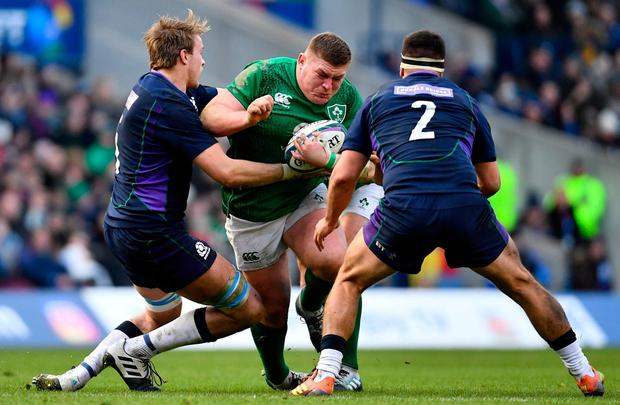 Tadhg Furlong of Ireland is tackled by Jonny Gray, left, and Stuart McInally of Scotland during the Guinness Six Nations Rugby Championship match between Scotland and Ireland at the BT Murrayfield Stadium in Edinburgh, Scotland. Photo by Ramsey Cardy/Sportsfile