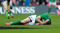 Ireland's Johnny Sexton lies injured against Scotland during the Guinness Six Nations match at BT Murrayfield on Saturday, Edinburgh. Graham Stuart/PA Wire