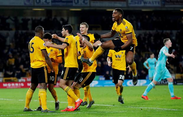 Wolverhampton Wanderers' Willy Boly celebrates scoring their first goal with team mates