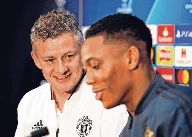United caretaker manager Ole Gunnar Solskjaer with Anthony Martial. Photo: Martin Rickett/PA Wire