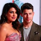 Indian actress Priyanka Chopra and US singer Nick Jonas attend the premiere of