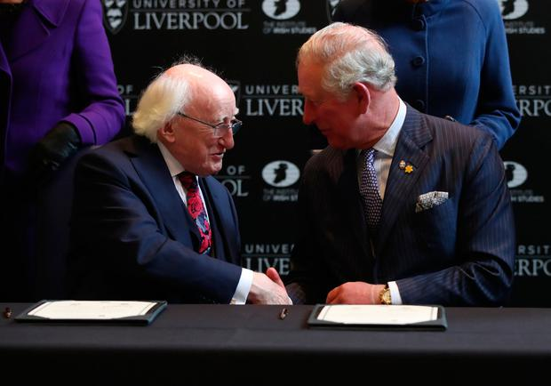 The Prince of Wales and Irish President Michael D Higgins watched by the Duchess of Cornwall and Sabina Coyne sign a charter during a reception at Victoria Gallery and Museum, University of Liverpool, to celebrate Charles' and President Higgins' joint patronage of the Liverpool Institute of Irish Studies. Danny Lawson/PA Wire