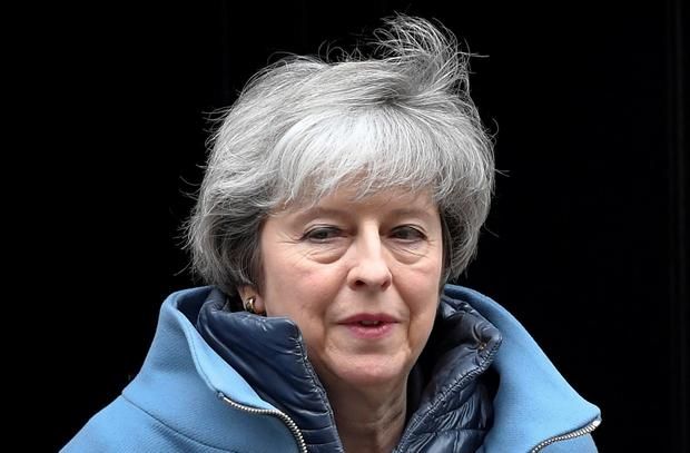 Sign of progress: Theresa May made light of the meeting. Photo: REUTERS