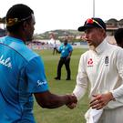 England's Joe Root shakes hands with West Indies' Shannon Gabriel after the match