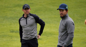 Rory McIlroy, left, and his amateur partner Mark Wahlberg walk the course during the pro-am round at the Genesis Open golf tournament at Riviera Country Club, Los Angeles, yesterday. Photo: Reed Saxon/AP