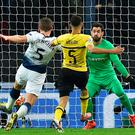 Tottenham defender Jan Vertonghen (left) shoots to score their second goal against Dortmund at Wembley last night. Photo: Glyn Kirk/Getty Images