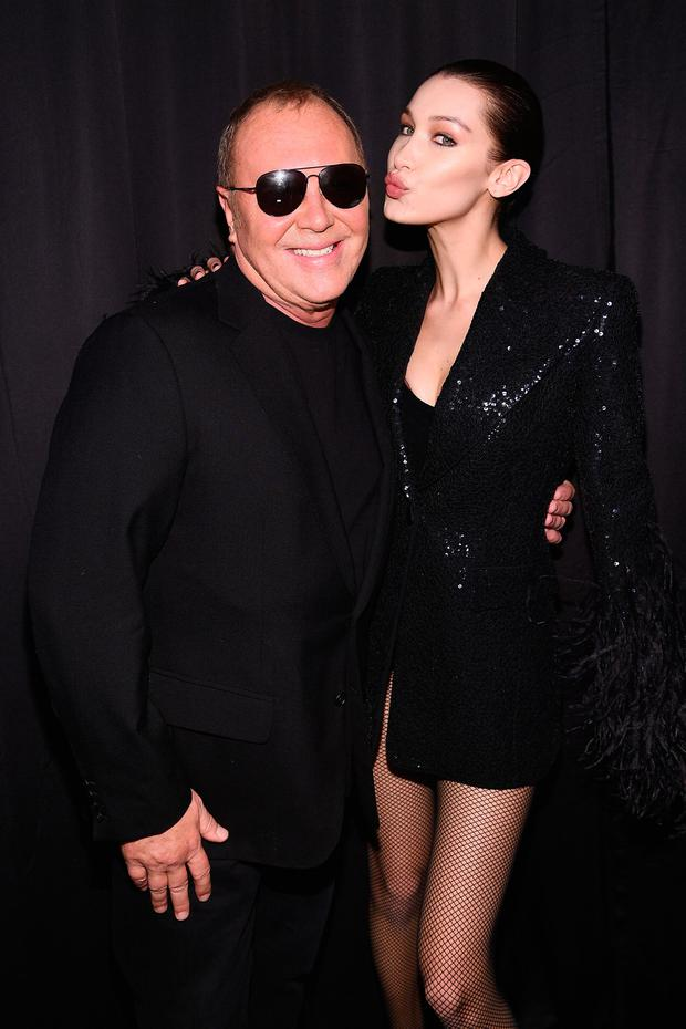 Michael Kors and Bella Hadid pose backstage during Michael Kors Collection Fall 2019 Runway Show at Cipriani Wall Street on February 13, 2019 in New York City. (Photo by Dimitrios Kambouris/Getty Images for Michael Kors)
