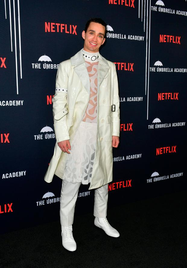From the cast, actor Robert Sheehan arrives for the premiere of Netflix's