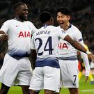 Tottenham's Son Heung-min celebrates scoring their first goal with Serge Aurier and Moussa Sissoko