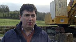 Beef farmer Dessie McManus is interviewed by Reuters in front of the 'border buster' JCB digger on the border near Kinawley in Northern Ireland and Swanlinbar in Ireland, in this still image taken from video on February 6, 2019. REUTERS/Reuters TV