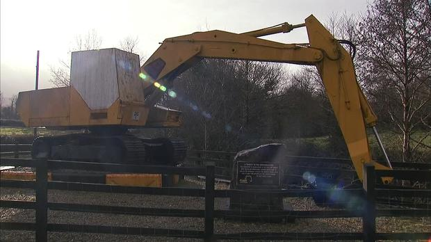 The 'border buster' JCB digger stands on the border near Kinawley in Northern Ireland and Swanlinbar in Ireland, in this still image taken from video on February 6, 2019. REUTERS/Reuters TV