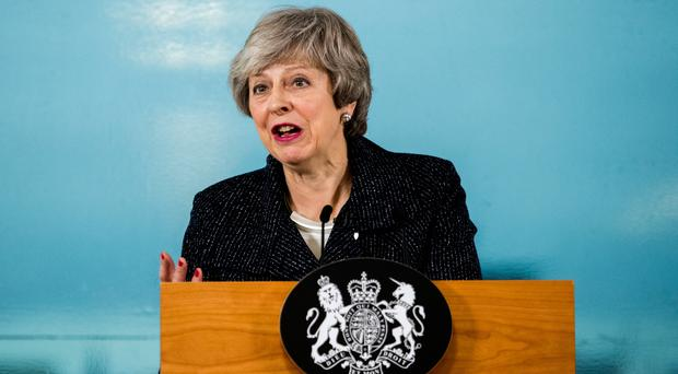 More woe for Theresa May as three UK Conservatives quit party in protest at 'disastrous Brexit'