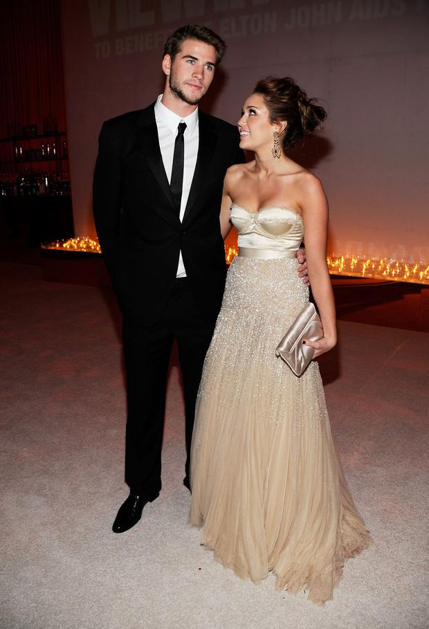 Liam Hemsworth and Singer/Actress Miley Cyrus attend the 18th Annual Elton John AIDS Foundation Academy Award Party at Pacific Design Center on March 7, 2010 in West Hollywood, California. (Photo by Larry Busacca/Getty Images)