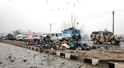 Indian soldiers examine the debris after an explosion in Lethpora in south Kashmir's Pulwama district February 14, 2019. REUTERS/Younis Khaliq