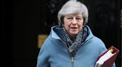 Absent: Theresa May was not in Parliament for the defeat. Photo: Reuters