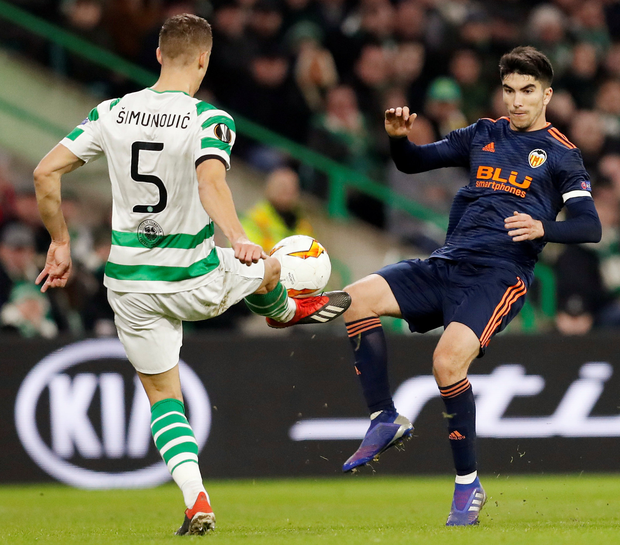 Valencia's Carlos Soler in action with Celtic's Jozo Simunovic. Photo: Reuters