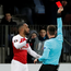 Arsenal's Alexandre Lacazette is shown a red card by referee Srdjan Jovanovic. Photo: Reuters