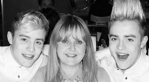 John and Edward shared a photo of themselves with their mother Susanna with a tribute on social media. PIC: Jedward/Twitter