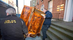 Furniture is removed from solicitor Gerald Kean's office on Upper Pembroke Street, Dublin 2. Pic:Mark Condren