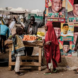 Ballot: A man sells vegetables next to electoral posters in the Nigerian city of Mubi, Adamawa State, ahead of today's presidential election. Photo: AFP/Getty Images