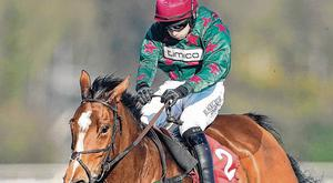 Jonathan Burke steers Glen Forsa over the last on the way to springing a big surprise in yesterday's Kingmaker Novices' Chase at Sandown. Photo: Alan Crowhurst/Getty Images