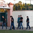 Friends of Emiliano Sala arrive to the club to pay their respects during a vigil at Sala's boyhood club San Martin de Progreso