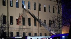 Russian Emergency employees work at the scene of the collapse building of the Saint Petersburg National Research University of Information Technologies, Mechanics and Optics in St. Petersburg, Russia (AP Photo/Dmitri Lovetsky)