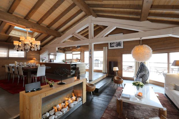 Le Praz, Courchevel — Dual-season, 305sqm four-bed chalet. Panoramic mountain views, indoor heated pool, squash court, double garage. Price reduced to €3.6m; SnowOnly.com.