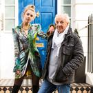 Paul Costelloe and his model in his 'rock chick' printed velvet slimline jacket