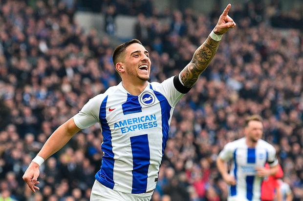 1a27240fa51 TOPSHOT - Brighton s French midfielder Anthony Knockaert celebrates scoring  the opening goal. (Photo by