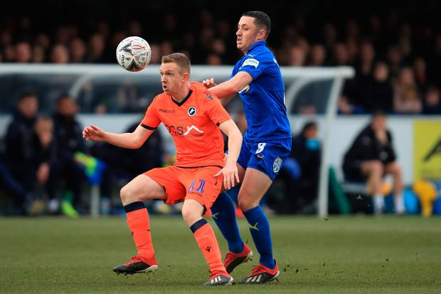 Shane Ferguson of Millwall in action with Anthony Hartigan of AFC Wimbledon. Photo: Marc Atkins/Getty Images