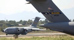 A second United States Air Force C-17 cargo plane loaded with humanitarian aid lands at Camilo Daza airport in Cucuta, Colombia, Saturday (AP Photo/Fernando Vergara)