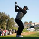 Rory McIlroy, of Northern Ireland, tees off on the ninth hole as second round play continues during the Genesis Open golf tournament at Riviera Country Club on Saturday, Feb. 16, 2019, in the Pacific Palisades area of Los Angeles. (AP Photo/Ryan Kang)
