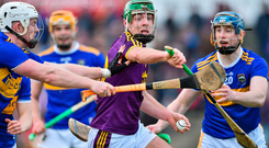 Aidan Nolan of Wexford in action against Michael Breen and Jason Forde of Tipperary