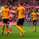 Ivan Cavaleiro of Wolverhampton Wanderers (7) celebrates as he scores his team's first goal with Matt Doherty