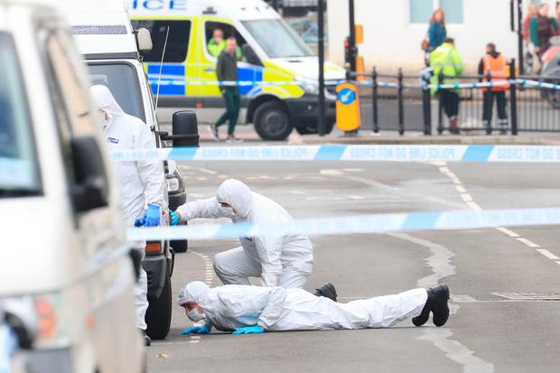 Forensics officers at the scene where Abdul Deghayes was found injured in the passenger seat of a Volkswagen Polo, near St Joseph's Church in Brighton Photo: Gareth Fuller/PA Wire
