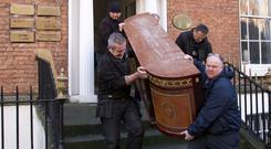 Orders: Workers for the Dublin City Sheriff remove items from Gerald Kean's offices in Dublin. Photo: Colin O'Riordan