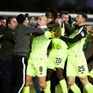 Celtic captain Scott Brown celebrates with the fans after he scores his side's late winner