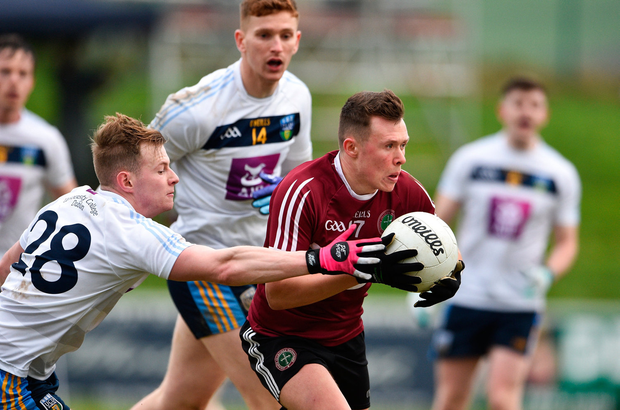 Ryan McSherry of St Mary's University in action against Peter Healy of UCD. Photo by Matt Browne/Sportsfile