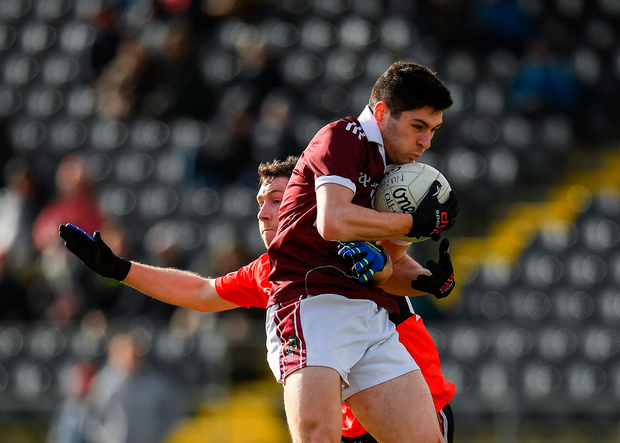 Nathan Mullen of NUIG in action against Michael Flood of UCC. Photo by Seb Daly/Sportsfile