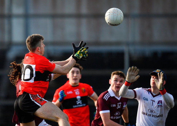 Conor Geaney of UCC, left, scores his side's fourth goal. Photo by Seb Daly/Sportsfile
