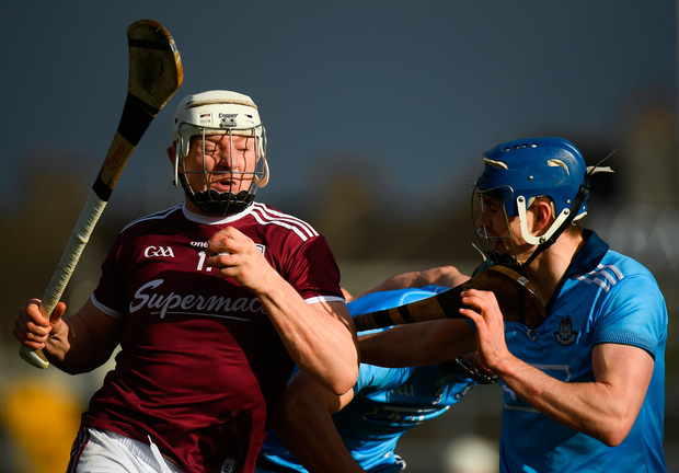 Eyes wide shut: Joe Canning braces himself for impact with Dublin's Seán Moran during yesterday's during Allianz HL Division 1B clash at Pearse Stadium. Photo: Harry Murphy/Sportsfile