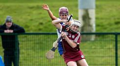 Galway's Ailish O'Reilly is challenged by Iona Heffernan of Waterford. Photo: ©INPHO/Laszlo Geczo
