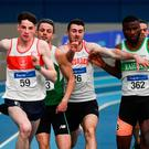 Thomas Barr (second from left) is squeezed out of contention in the men's 400m at the National Indoor Athletics Championships in a race won by Cillín Greene (No 59). Photo by Sam Barnes/Sportsfile