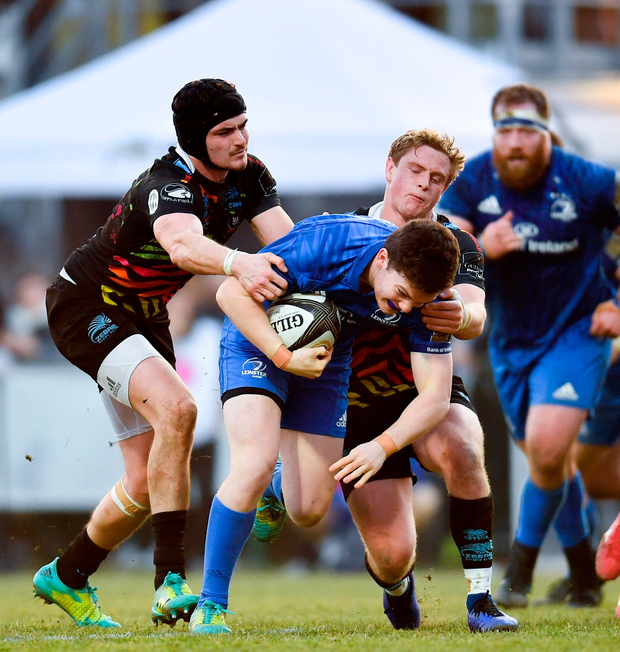 Hugh O'Sullivan of Leinster is tackled by Carlo Canna, left, and Joshua Renton of Zebre. Photo by Ramsey Cardy/Sportsfile