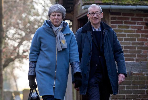 Theresa May and her husband Philip attend church yesterday. Photo: PA