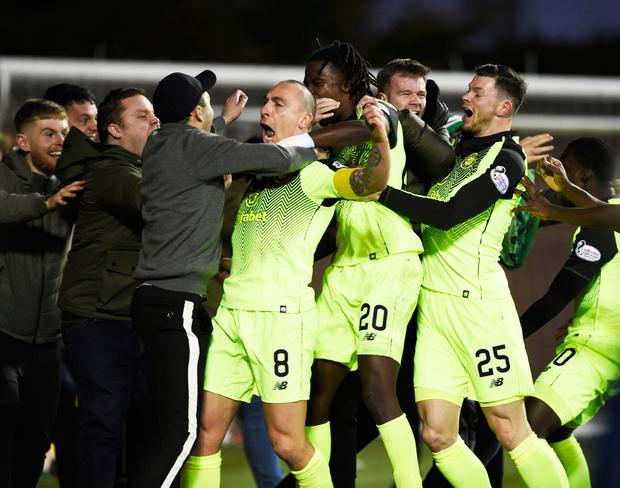 Great Scott: Scott Brown celebrates among the Celtic supporters after his late winner took all three points against Kilmarnock. Photo: Ian Rutherford/PA Wire.