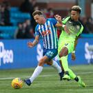 Eamonn Brophy of Kilmarnock vies with Scott Sinclair of Celtic. Photo by Ian MacNicol/Getty Images