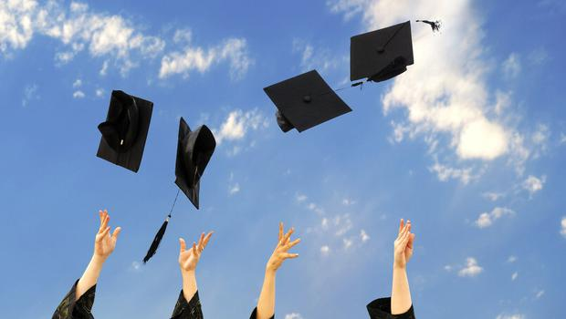Time to celebrate: Jobs are easier to find for new graduates. Stock Image